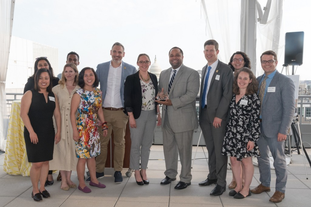 District of Columbia City Administrator Rashad Young and Representatives from The Lab @ DC accepting the 2019 COSSA Public Impact Award